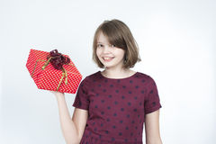 Portrait of the girl with a gift box in his hands. Royalty Free Stock Photos
