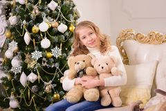 Portrait of a girl with gifts on Christmas New Year. The portrait of a girl with gifts on Christmas New Year Royalty Free Stock Photography