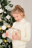 Portrait of a girl with gifts on Christmas New Year. The portrait of a girl with gifts on Christmas New Year Stock Images