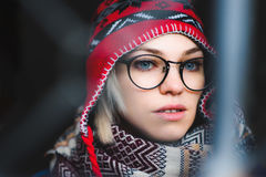 Portrait of a girl with glasses and hat stock photography