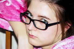 Portrait of a girl with glasses royalty free stock photography
