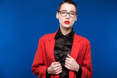 Portrait of a girl with glasses and a red jacket Royalty Free Stock Image
