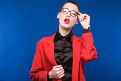 Portrait of a girl with glasses and a red jacket Stock Photography