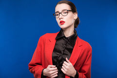 Portrait of a girl with glasses and a red jacket Royalty Free Stock Photography