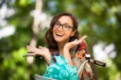 Girl with glasses and vintage bicycle stock images