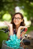 Girl with glasses and vintage bicycle stock photos