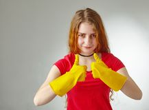 Girl with gloves showing pointing up Stock Photos