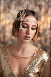 Portrait of a girl in a gold dress Royalty Free Stock Photography