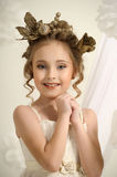 Portrait of a girl with a golden wreath Royalty Free Stock Photos