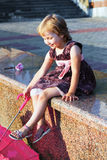 Portrait of the girl. Portrait of the girl on the granite embankment Stock Images