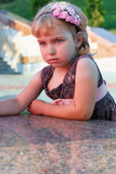 Portrait of the girl on the granite embankment. Portrait of the sad girl on the granite embankment Stock Photo
