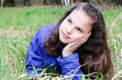 Portrait of the girl in grass Royalty Free Stock Images