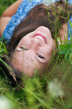 Portrait of a girl in the grass Stock Photos