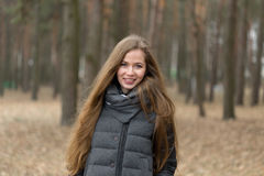 Portrait of a girl in a gray jacket in the open air Royalty Free Stock Photos