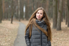Portrait of a girl in a gray jacket in the open air Royalty Free Stock Image