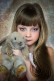 Portrait of girl with gray rabbit Royalty Free Stock Photos