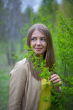Portrait of a girl with green bush Royalty Free Stock Photography