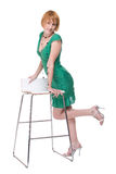 Portrait girl in green dress over chair Royalty Free Stock Photos