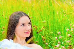 Portrait of a girl in green grass and clover Royalty Free Stock Photo