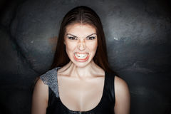 Portrait girl with grimace of anger on his face. Royalty Free Stock Images