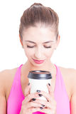 Portrait of girl at gym holding coffee cup Stock Image