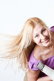 Portrait of a girl with a hairdryer Stock Photography
