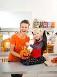 Portrait of girl in halloween bat costume with mother Royalty Free Stock Photos
