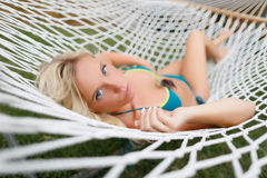 Blonde girl in a hammock Stock Photos