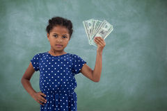 Portrait of girl with hand on hip showing paper currency Royalty Free Stock Photography