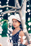 Portrait of a girl   among hanging shells decoration on the beac Royalty Free Stock Images