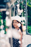 Portrait of a girl   among hanging shells decoration on the beac Royalty Free Stock Photos