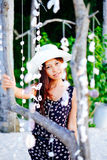 Portrait of a girl among hanging shells decoration on the beach Royalty Free Stock Image