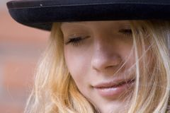 Portrait of the girl in a hat royalty free stock photography