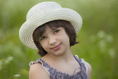 Portrait of the girl in the hat. In the meadow Stock Images