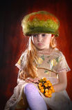Portrait of  girl in  hat with  bouquet of flowers Royalty Free Stock Images
