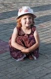 Portrait of the girl in a hat. Portrait of the girl in a hat at city square Stock Image