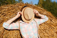 Portrait of girl in a hat on field with hay bales Stock Images