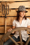 Portrait of girl in hat in hayloft with pitchfork Royalty Free Stock Images