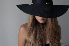 Portrait of a girl in a hat with a large brim posing fashion. 1 stock photo