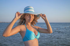 Portrait of a girl in a hat at sea Royalty Free Stock Image