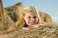 Portrait of  girl on hay Stock Photos
