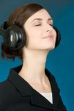 Portrait of girl in headphones Stock Image