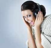 Portrait of a girl in headphones listening music Royalty Free Stock Photos