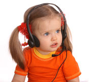 Portrait of girl in headset. Portrait of girl in orange t-shirt and headset Stock Image