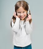 Portrait of girl in headset. Stock Photography