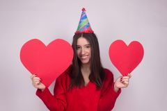 Portrait girl with hearts isolated on white. Celebration birthday happiness Royalty Free Stock Photo