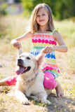 Portrait of a Girl with her beautiful dog outdoors Royalty Free Stock Image