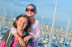 Portrait of a girl with her mother near yachts Royalty Free Stock Photo