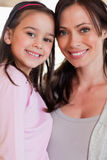 Portrait of a girl and her mother posing Royalty Free Stock Photo