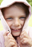 Portrait Of Girl Hiding Face In Pink Hooded Top Stock Photo